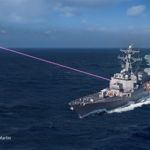 Arleigh Burke class destroyer fires a directed energy HELIOS weapon